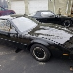 Two KITTS from the show Knight Rider